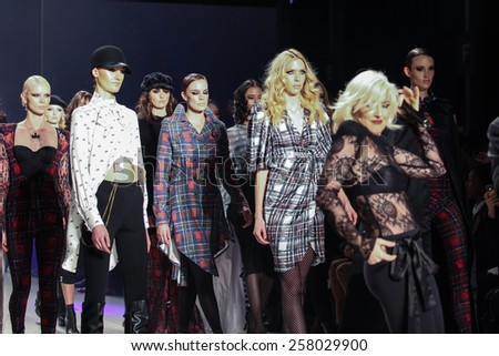 NEW YORK - FEBRUARY 13: A models and designer Estel Day walks the runway at the Mark & Estel Fall/Winter 2015 collection during Mercedes-Benz Fashion Week in New York on February 13, 2015. - stock photo
