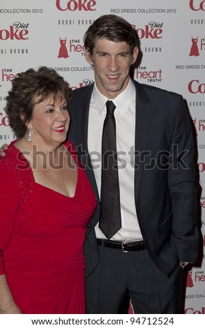 NEW YORK - FEBRUARY 08: Debbie & Michael Phelps attend fashion show for the Heart Truth Red Dress Collection 2012 at Hammerstein Ballroom at Manhattan Center in Manhattan on February 08, 2012 in New York City, NY