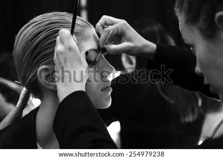 NEW YORK - FEBRUARY 16, 2015: Devon Windsor prepares backstage at the Carolina Herrera Fall 2015 fashion show during Mercedes-Benz Fashion Week at The Theatre at Lincoln Center  - stock photo