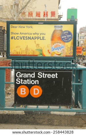 NEW YORK - FEBRUARY 26, 2015: Grand Street Subway Station entrance in Chinatown. Owned by the NYC Transit Authority, the subway system has 469 stations in operation - stock photo