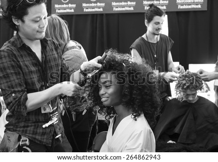 New York - February 12, 2015: Kayla Clarke prepares backstage at the Desigual Fall 2015 fashion show during Mercedes-Benz Fashion Week at The Theatre at Lincoln Center
