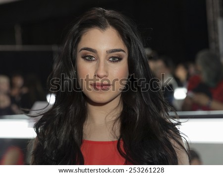 NEW YORK - FEBRUARY 12, 2015: Lauren Jauregui prepares backstage for the Heart Truth Red Dress Collection 2015 fashion show as part of Fall 2015 Mercedez-Benz Fashion Week at Lincoln Center - stock photo