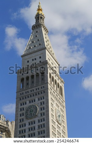 NEW YORK - FEBRUARY 19, 2015: Met Life Tower with iconic clock in Flatiron district in Manhattan. Clock face is 26.5 feet (8 m) in diameter with each number being four feet (1.2 m) tall - stock photo