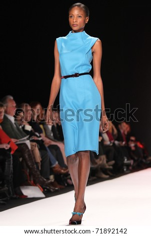 NEW YORK - FEBRUARY 14: Model Aminata Niaria walks the runway at the Carolina Herrera Fall 2011 Collection presentation during Mercedes-Benz Fashion Week on February 14, 2011 in New York. - stock photo