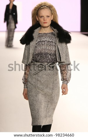 - stock-photo-new-york-february-model-hanne-gaby-odiele-walks-the-runway-at-the-carolina-herrera-fw-98234660