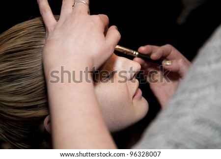 NEW YORK - FEBRUARY 16:Model prepares backstage for Zuzu Kim presentation of Fall/Winter 2012 collection at Bennet Media Studio during Mercedes-Benz Fashion Week on February 16, 2012 in NYC