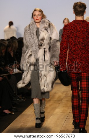 NEW YORK - FEBRUARY 15: Model Vlada Roslyakova walks the runway at the Michael Kors FW 2012 collection presentation during Mercedes-Benz Fashion Week on February 15, 2012 in New York.
