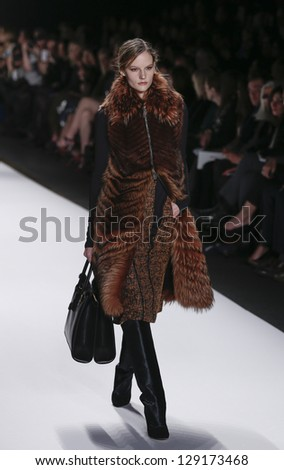 NEW YORK - FEBRUARY 13: Model walks runway during Fall/Winter 2013 presentation for J. Mendel collection at Mercedes-Benz Fashion Week at Lincoln Center on February 13, 2013 in New York