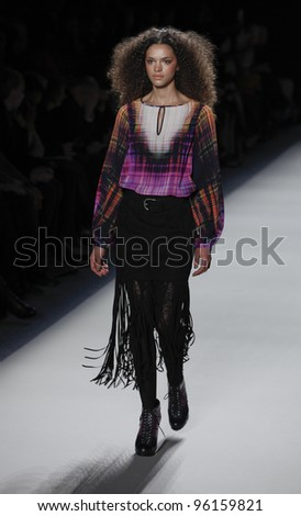 NEW YORK - FEBRUARY 10: Model walks runway for collection by Nicole Miller during Fashion week at Lincoln Center in Manhattan on February 10, 2012 in New York City