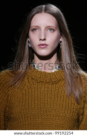 NEW YORK - FEBRUARY 13: Model walks the runway at the Theyskens' Theory FW 2012 collection presentation during Mercedes-Benz Fashion Week on February 13, 2012 in New York.