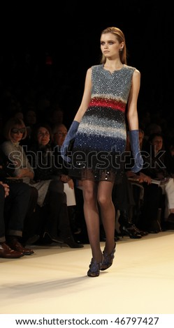 NEW YORK - FEBRUARY 15: Model walks the runway for Carolina Herrera Collection at Fall 2010 during Mercedes-Benz Fashion Week as Anna Wintour of Vogue watches on February 15, 2010 in New York