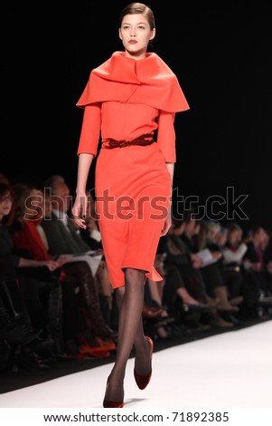 NEW YORK - FEBRUARY 14: Model Yulia Kharlaponova walks the runway at the Carolina Herrera Fall 2011 Collection presentation during Mercedes-Benz Fashion Week on February 14, 2011 in New York.