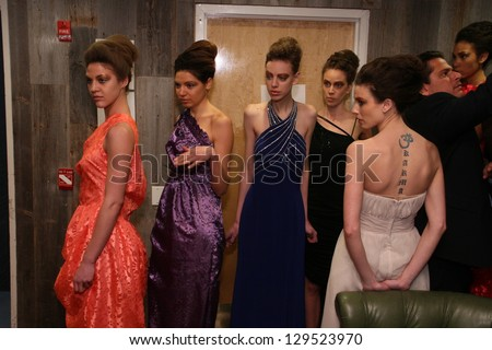 NEW YORK - FEBRUARY 10: Models gets ready backstage for Ola Style collection at Club Stage48 during Planet Chic Fashion Week on February 10, 2013 in New York City - stock photo