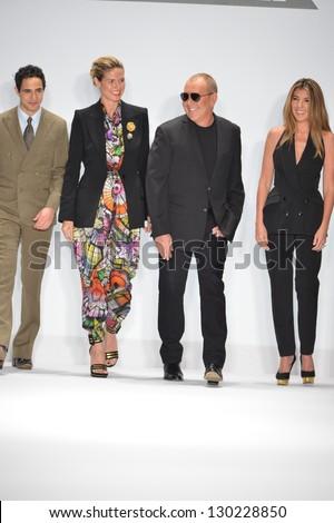 NEW YORK - FEBRUARY 08: Zac Posen, Heidi Klum, Tim Gunn and Nina Garcia walk the runway at the Project Runway Fall Winter 2013 fashion show during Mercedes-Benz Fashion Week on February 8, 2013 in NYC - stock photo