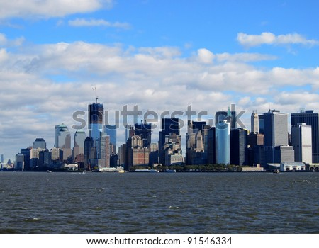 NEW YORK HARBOR - OCTOBER 21: The new One World Trade Center already dominates the New York City skyline, shown on October 21, 2011, with still over a year remaining on its construction.