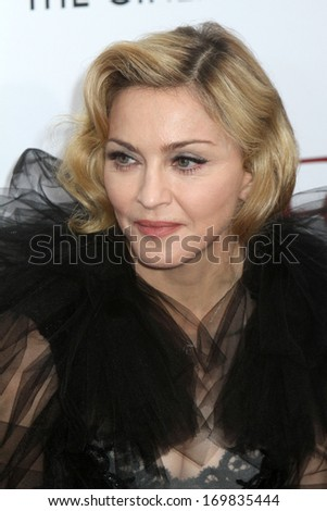 """NEW YORK - JAN 23: Madonna attends the premiere of """"W.E."""" at the Ziegfeld Theater on January 23, 2012 in New York City. - stock photo"""