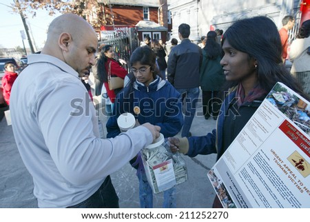 NEW YORK - JAN 1:  Volunteers collect donations for Sri Lankan tsunami victims outside of the Hindu Ganesh Temple January 1, 2005 in Flushing, NY. - stock photo