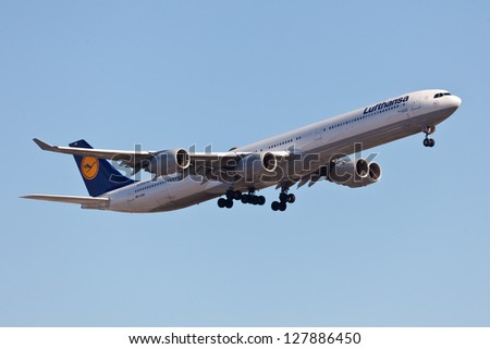 NEW YORK - JANUARY 6: AIRBUS A340-600 Lufthansa approaches JFK Airport located in New York USA on January 6, 2013. A340-600 was designed as an early-generation Boeing 747 replacement - stock photo