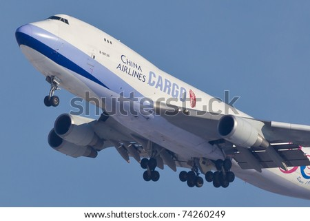 NEW YORK - JANUARY 12: Boeing 747 China Cargo climbs after takeoff from JFK in New York, USA on January 12, 2011 747 most popular cargo plane used by commercial airlines Her nickname: Queen of the sky