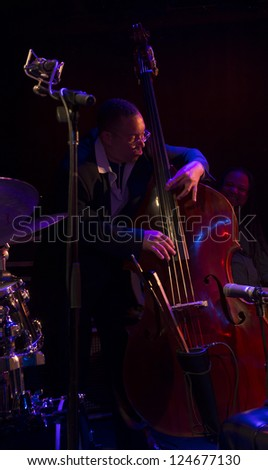 """NEW YORK - JANUARY 11: Hassan Shakur bass performs with Monti Alexander """"Harlem - Kingston Express"""" band on stage as part of NYC Winter Jazz Festival at Le Poisson Rouge on January 11 2013 in New York - stock photo"""