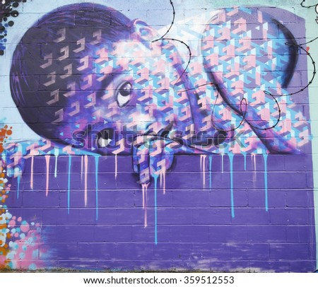 NEW YORK - JANUARY 7, 2016: Mural art at Wellington Court in Astoria section in Queens. A mural is any piece of artwork painted or applied directly on a wall, ceiling or other large permanent surface