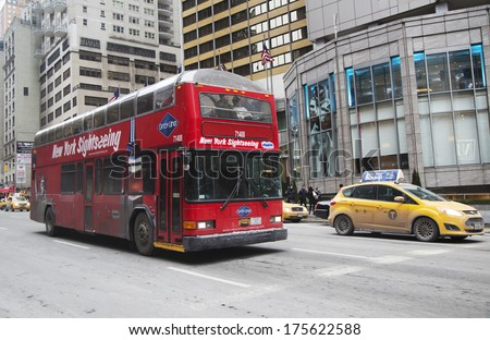 NEW YORK - JANUARY 26: New York Sightseeing Hop on Hop off bus in Manhattan on January 26, 2014. Since 1926, Gray Line New York is the source for  best double decker bus and deluxe motor coach tours - stock photo