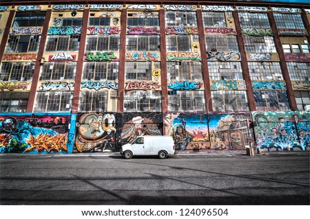 """NEW YORK - JANUARY 6, 2013: 5 Pointz on January 6, 2013 in New York. The 5 Pointz is an outdoor art exhibit space in Long Island City, New York, considered to be the worlds premiere graffiti Mecca."""" - stock photo"""