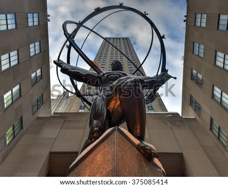 New York - January 24, 2016: Snow covered Atlas Statue at Rockefeller Center in New York. The Atlas Statue is a bronze statue in front of Rockefeller Center in midtown Manhattan, New York City. - stock photo