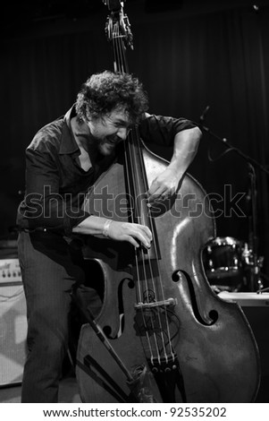 NEW YORK - JANUARY 07: Stephan Crump plays bass with Vijay Iyer trio as part of NYC Winter Jazz Festival at Le Poisson Rouge on January 07, 2012 in New York City