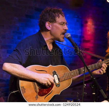 NEW YORK - JANUARY 12: Wade Schuman Guitar performs with Hazmat Modine band on stage as part of NYC Winter Jazz Festival at The Bitter End on January 12, 2013 in New York City - stock photo
