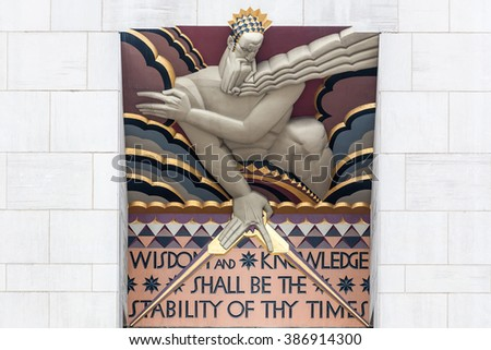 NEW YORK - JANUARY 11,2009: Wisdom, an art deco piece by Lee Lawrie over the entrance of 30 Rockefeller plaza on JANUARY 11,2009 in New York, NY - stock photo