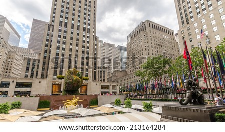 NEW YORK - JUL 17: Jeff Koons' flower sculpture Split-Rocker on display in Rockefeller Center on July 17, 2014 in New York. - stock photo