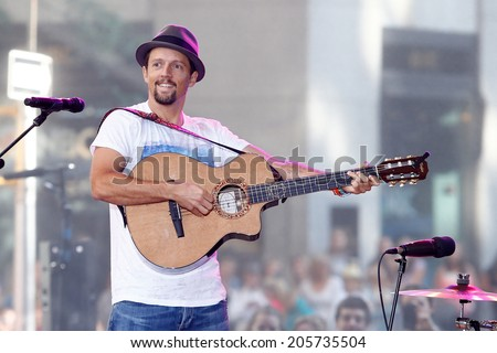 NEW YORK-JUL 18: Recording artist Jason Mraz performs in concert at NBC's 'Today Show' at Rockefeller Plaza on July 18, 2014 in New York City. - stock photo