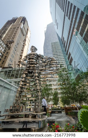 NEW YORK - JUL 22: Superhero sculpture by Antonio Pio Saracino on July 22, 2014 in Bryant Park, New York. Bryant Park is a 9.603-acre public park located in the New York City borough of Manhattan. - stock photo