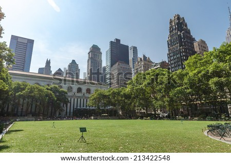 NEW YORK - JUL 22: The Great Lawn in Bryant Park on July 26, 2014 in New York. Bryant Park is a 9.603-acre public park located in the New York City borough of Manhattan. - stock photo