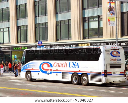NEW YORK - JULY 15: A Coach USA bus on July 15, 2011 in New York. Coach USA is a holding company for various American transportation service providers providing scheduled intercity bus services. - stock photo