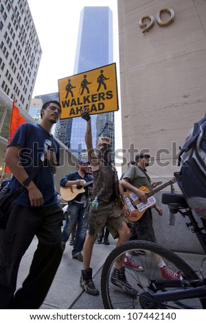NEW YORK-JULY 11: A protester holds a sign that reads 'Walkers Ahead' during the Occupy Guitarmy march in Lower Manhattan during the #99MileMarch from Philly to NYC on July 11, 2012 in New York, NY. - stock photo