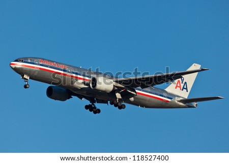 NEW YORK - JULY 22:Boeing 777 American Airline approaching JFK in New York, USA on July 22, 2012. American Airline is on of the oldest American airlines and one of the biggest in the world - stock photo
