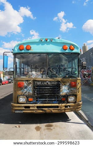 NEW YORK - JULY 23, 2015: Bus covered with graffiti in Brooklyn. Outdoor art gallery known as the Bushwick Collective has most diverse collection of street art in Brooklyn