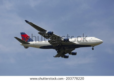 NEW YORK -JULY 8: Delta Airline Boeing 747 in New York sky before landing at JFK Airport on July 8, 2014. The Boeing 747 is a wide-body commercial airliner and  the world's most recognizable aircraft - stock photo