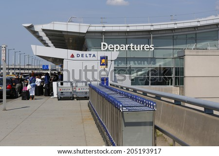 NEW YORK- JULY 10: Delta Airline Terminal 4 at John F Kennedy International Airport in New York on July 10, 2014. JFK is one of the biggest  airports in the world with 4 runways and 8 terminals