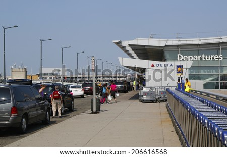 NEW YORK- JULY 22: Delta Airline Terminal 4 at John F Kennedy International Airport in New York on July 22, 2014. JFK is one of the biggest airports in the world with 4 runways and 8 terminals - stock photo
