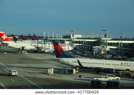 NEW YORK- JULY 2, 2016: Delta Airlines and Swiss Airlines planes on tarmac at Terminal 4 at JFK International Airport. JFK is one of the biggest airports in the world with 4 runways and 8 terminals