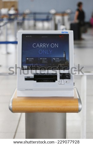 NEW YORK- JULY 10: Delta Airlines self service kiosk in Terminal 4 at John F Kennedy International Airport on July 10, 2014. Delta Air Lines operates over 5,000 flights every day. - stock photo