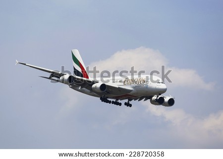 NEW YORK -JULY 8: Emirates Airline Airbus A380 in New York sky before landing at JFK Airport on July 8, 2014. The Airbus A380 is a double-deck, wide-body, world's largest passenger airliner - stock photo