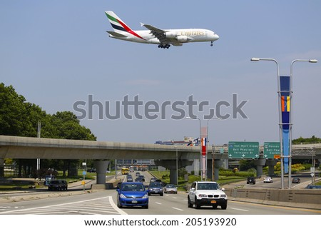 NEW YORK -JULY 8: Emirates Airline Airbus A380 on approach to JFK International Airport in New York on July 8, 2014.  The Airbus A380 is a double-deck, wide-body, world's largest passenger airliner  - stock photo