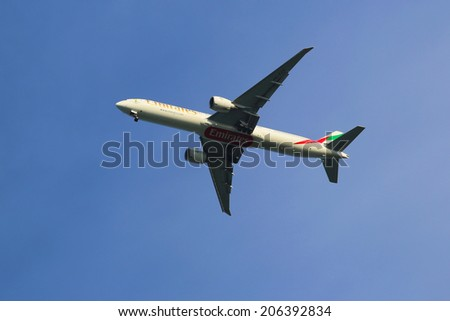 NEW YORK - JULY 6: Emirates Airline Boeing 777 in New York sky before landing at JFK Airport on July 6, 2014 - stock photo