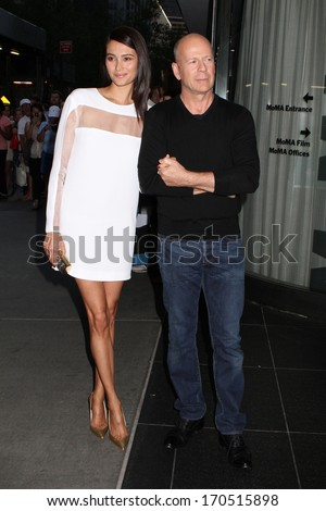 """NEW YORK - JULY 16: Emma Heming Willis and Bruce Willis attend a screening of """"Red 2"""" at the Museum of Modern Art on July 16, 2013 in New York City. - stock photo"""