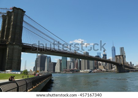 NEW YORK - JULY 21, 2016: Famous Brooklyn Bridge. The Brooklyn Bridge is the one of the oldest suspension bridges in the USA was completed in 1883 - stock photo