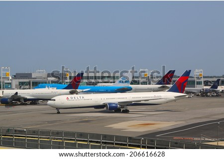 NEW YORK- JULY 22:  KLM Boeing 747 and Delta Airline planes at the gates at the Terminal 4 at John F Kennedy International Airport in New York on July 22, 2014 - stock photo